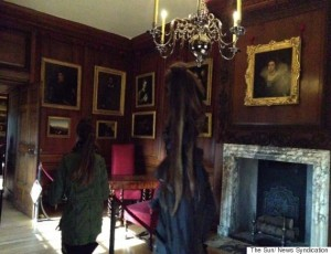 12YR OLD HOLLY McGEE (RIGHT) SHOWS MUM ANGIE & COUSIN BROOK 12, A GHOSTLY FIGURE THAT APPEARED AFTER SHE TOOK A PICTURE DURING A TRIP TO HAMPTON COURT.